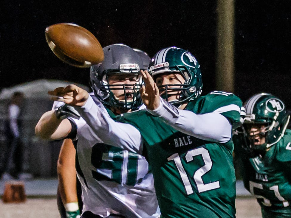 West Allis Hale quarterback Bryce Niebuhr (12) tries a forward pitch-out while under pressure at home against Wauwatosa West on Thursday, Sept. 27, 2018. The ball was intercepted by Wauwatosa West's Trevor Kuhl.