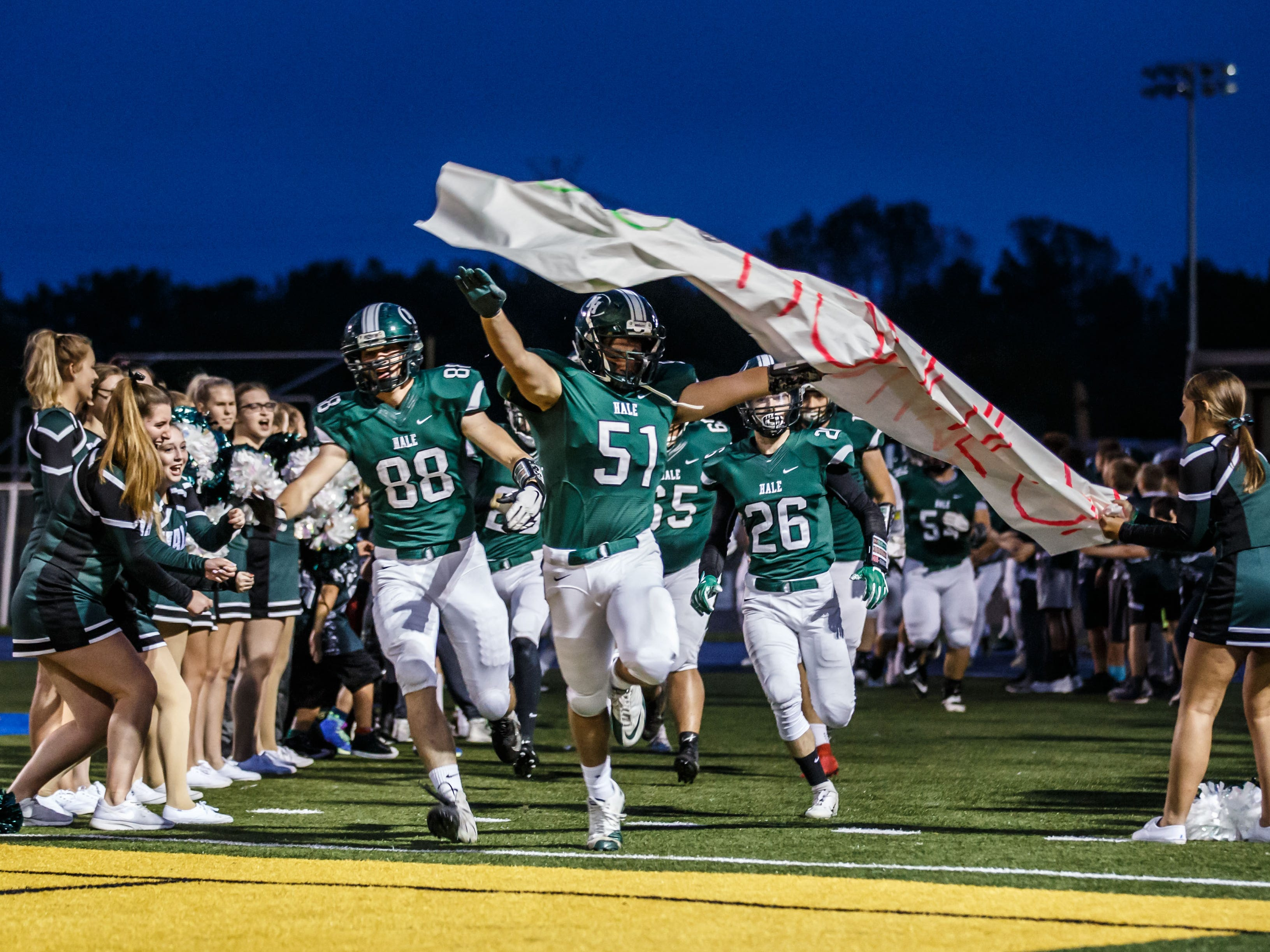 West Allis Hale senior Mario Delval (51) leads his team onto the field prior to the game at home against Wauwatosa West on Thursday, Sept. 27, 2018.