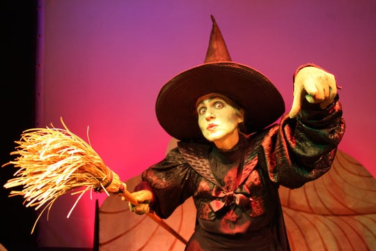 "The Wicked Witch of the West (played by Lori B.Lawrence, shown here in a 2011 production) casts a malevolent spell in ""The Wizard of Oz."" The stage version of the 1939 film will be shown Saturday in Morristown."