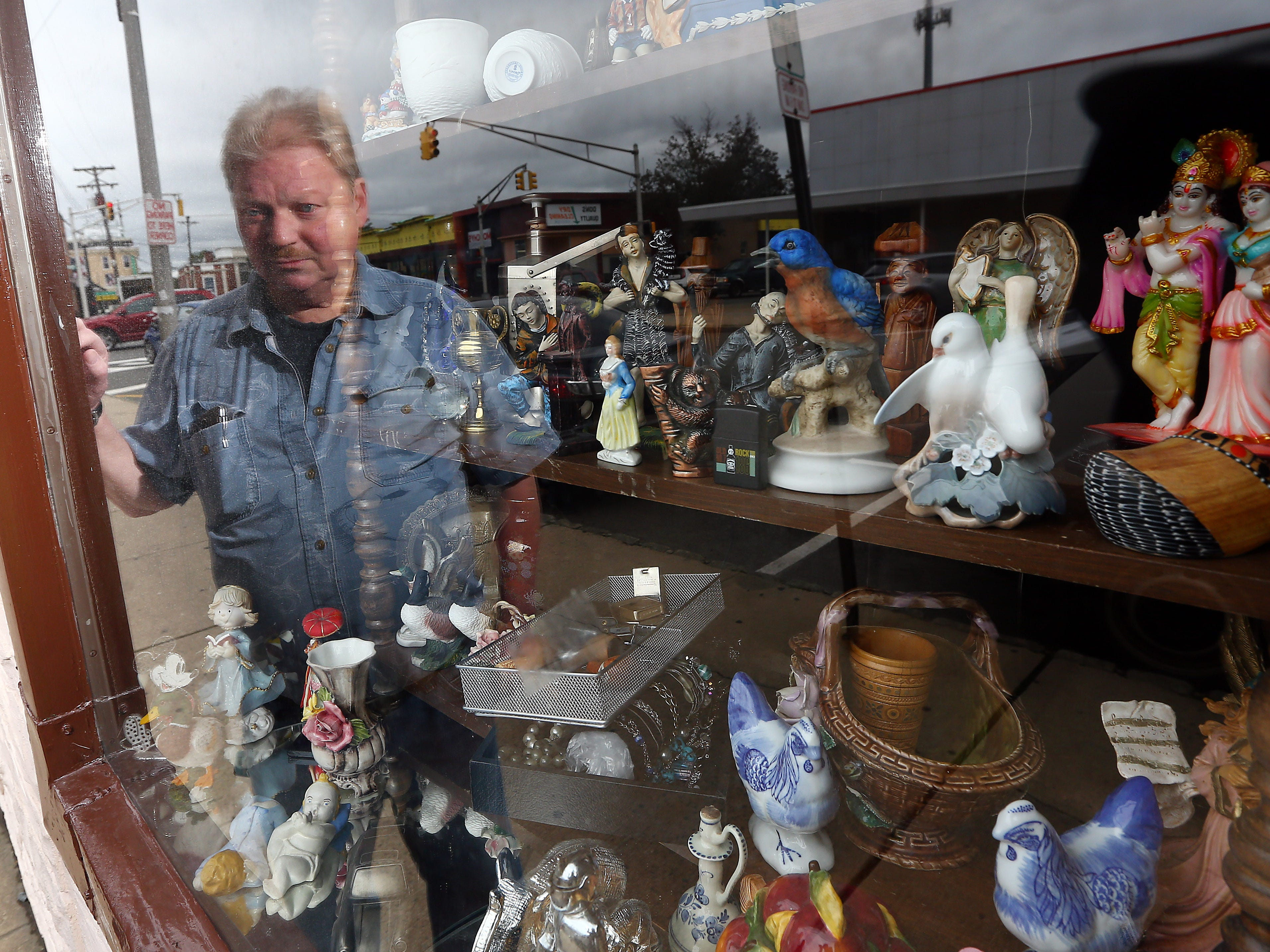 Stan Bush is reflected in the storefront window of his Morris Thrift Store in Dover. The store has been open for 40 years and will close at the end of the year. Stan and Maria Bush, the most recent owners are retiring and have sold it, the new owner will not keep it as a thrift store. September 28, 2018, Dover, NJ