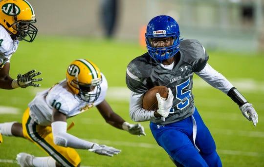 Lanier's Jacory Merritt (15) eludes Jeff Davis tacklers at Cramton Bowl in Montgomery, Ala., on Thursday September 27, 2018.