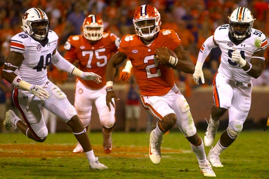 Clemson Tigers quarterback Kelly Bryant (2) carries the ball as Auburn linebacker Darrell Williams (49) and defensive lineman Nick Coe (91) chase during a game on Sept. 9, 2017, in Clemson, S.C.