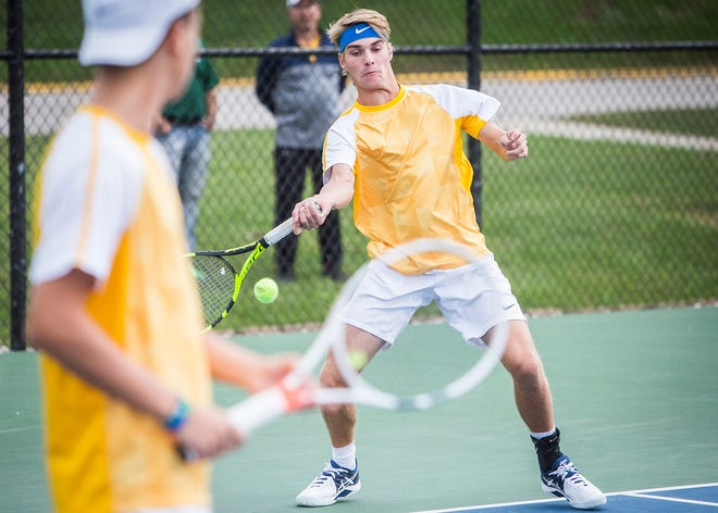 Delta's Joel Ashman and Brandon Jackson face off against Yorktown's Zachary Abrell and Charlie Hammock during their sectional at Delta High School Thursday, Sept. 27, 2018.