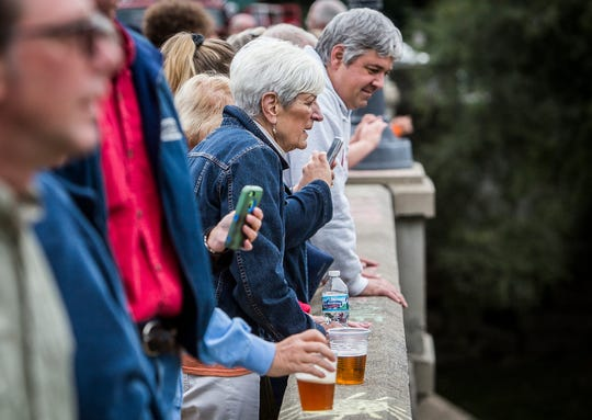 Attendees of the Muncie Bridge Dinner on the Washington Street bridge enjoyed local food vendors, live music from the Muncie Central Jazz Band and the Ball State School of Music as well as a bird's eye view of the Duck Derby race which raised  funds for Meridian Health Services Thursday evening.