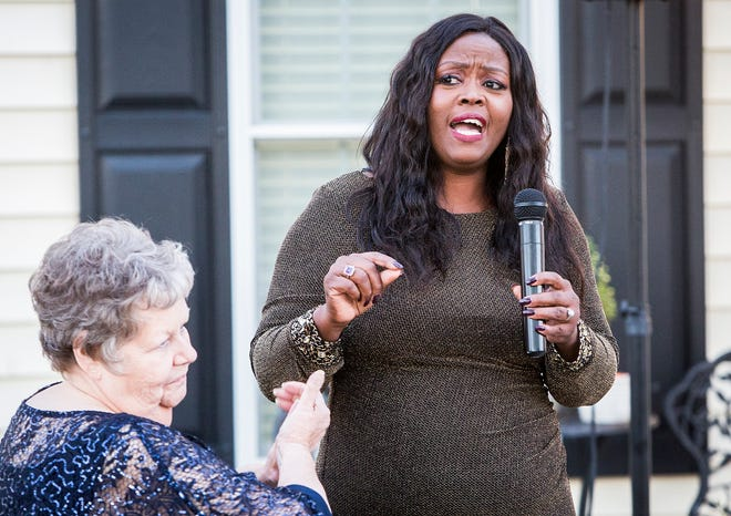 Congressional candidate Jeannine Lee Lake speaks during a fundraiser at her Muncie home.