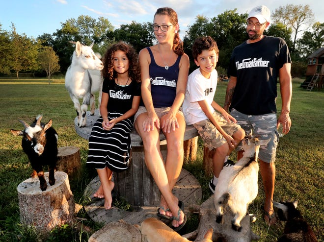The Hoens family, surrounded by some of the goats that call Sugarbush Farms homes. Pictured from left are daughter Laina Hoens, Mareen Hoens, son Finn Hoens, and Joe Hoens.