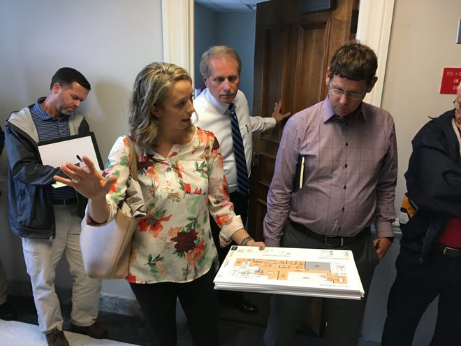 Afton Mooney, an interior designer with Gresham Smith, explains renovation plans on the fifth floor of the former Rutherford County Judicial Building to officials, including Mayor Bill Ketron, center, and Public Building Authority member Dow Smith, right, during a Thursday (Sept. 27, 2018) tour of the five-story building.