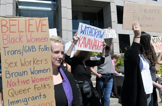 People protest against Judge Kavanaugh confirmation outside Sen. Corker's Nashville office on Friday, Sept. 28, 2018.