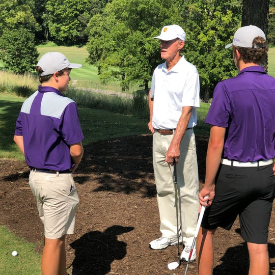 Former Father Ryan golfer and 1975 U.S. Open champion Lou Graham speaks with members of the Irish golf team earlier this season at Richland Country Club.