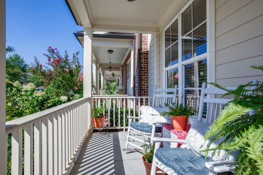 Many townhome residents love the close proximity of neighbors. This townhome's front porch creates a social environment to share with others in your community.