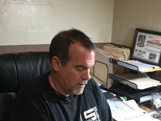 Jim Bennett at his desk at Mobiletech Automotive Repair in Mt. Juliet.