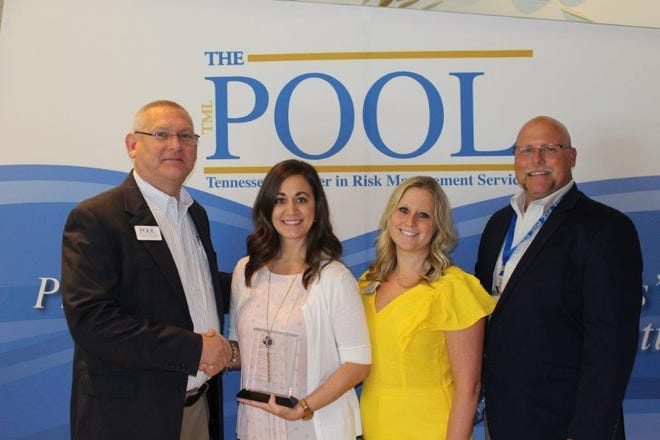 Gallatin risk manager JamiAnn Hannah (second from left) received an excellence award by The Pool. Pictured from left are Chester Darden, Middle Tennessee casualty loss control consultant with The Pool, Hannah, Callie Westerfield, director of member services with The Pool, and Bob Lynch, Middle Tennessee property conservation consultant with The Pool.