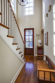Today's townhomes offer high-end finishes such as two-story foyers and hardwood floors.