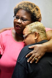 Sheila Clemmons-Lee, mother of police shooting victim Jocques Clemmons, consoles Vickie Hambrick, mother of Daniel Hambrick, at at Hambrick family press conference at Church of the Living God Friday, Sept. 28, 2018, in Nashville, Tenn.
