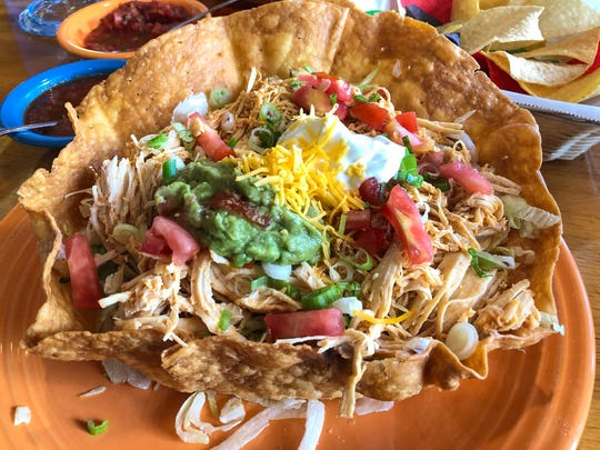 Taco salad, served with rice, beans lettuce, tomato, onion, guacamole, sour cream and cheese and chicken, from Senõr Tequila's in Bonita Springs, $10.99.
