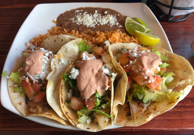 Jessy's Fish Tacos from Salsa Brava Mexican Grill in North Naples, Florida. A filet of seasoned fish in three soft flour tacos is topped with a spicy chipotle cream, pico de gallo, lettuce and queso fresco. Seved with rice and beans, $13.95.