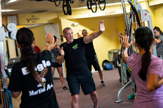 Robert Fletcher trains people during a self-defense class in Naples, Fla., on Friday, Sept. 14, 2018.