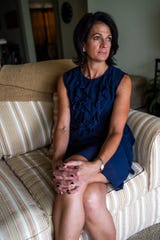 Lisa Tokes sits in her apartment in Naples, Fla., for an interview Friday, Sept. 14, 2018.
