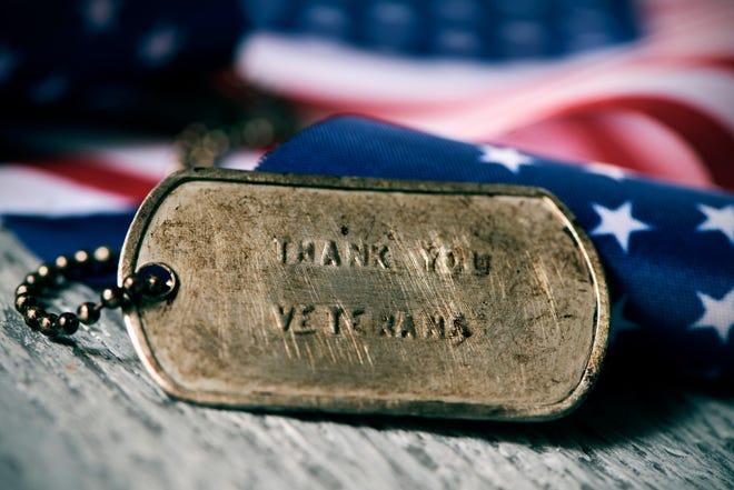 Closeup of a rusty dog tag.
