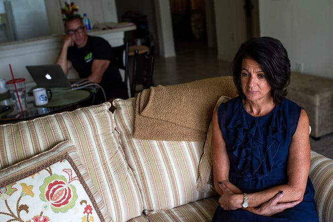 Lisa Tokes sits in her apartment in Naples, Fla., during an interview Friday, Sept. 14, 2018.