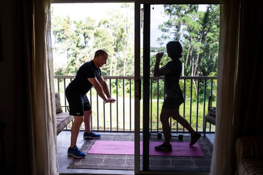 Robert Fletcher, left, and Lisa Tokes practice self-defense moves in Naples, Fla., on Friday, Sept. 14, 2018.