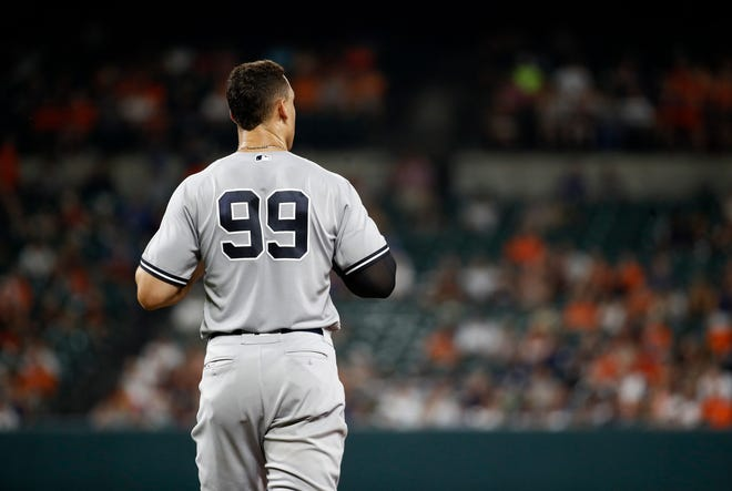 New York Yankees' Aaron Judge walks on the field between innings of a baseball game against the Baltimore Orioles, Tuesday, July 10, 2018, in Baltimore. (AP Photo/Patrick Semansky)