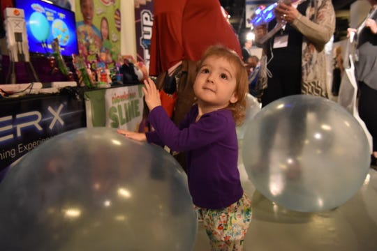 "Emma Horrigan, 2, plays with a ""super wubble bubble ball"" at the annual TTPM holiday hot toy predictions in New York, NY."