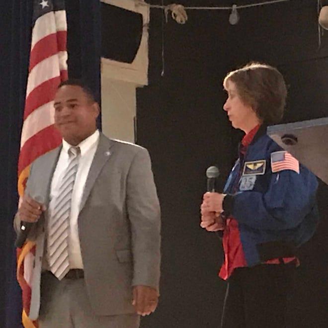 Passaic Mayor Hector Lora and Astronaut Ellen Ochoa at an assembly at Passaic's new science academy Friday morning.