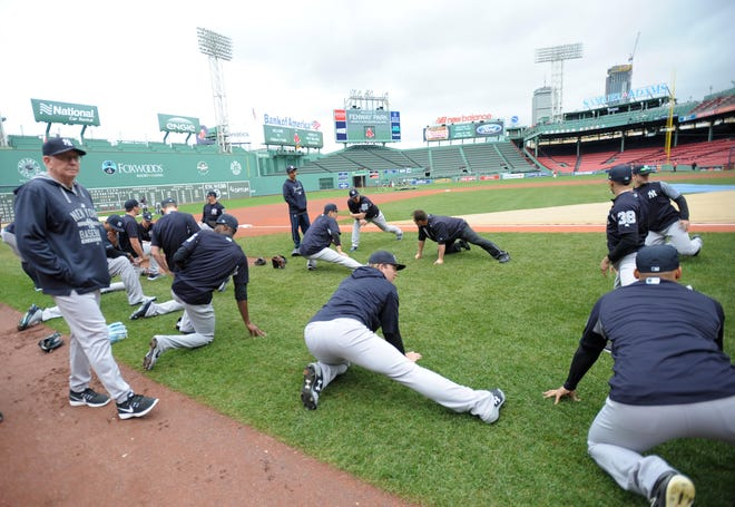 Sep 28, 2018; Boston, MA, USA; Members of the New York Yankees stretch prior to a game against the Boston Red Sox at Fenway Park.