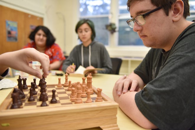 Students , at right, Rocco Trupiano, 17, of Ramsey, plays chess with Andrew Gallagher, 14, of Dumont, at the Paradigm Therapeutic Day School, which held a ribbon cutting ceremony at their facility in Midland Park Friday morning on September 28, 2018.