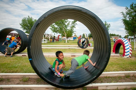 Discovery Child Development Center students Christian Schaper, left, and Riley Francis, both 4, have fun in a hamster wheel on Sept. 24 at the Mesilla Valley Maze.