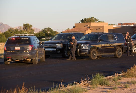 Las Cruces Police respond to a shooting last month near Las Cruces High School, where Juan Angel Pinedo was killed.