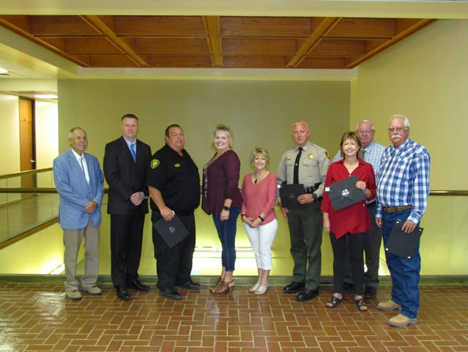 Pictured are Commission Vice Chairman James Walterscheid, Commissioner John Henry, Robert Conn, Commission Chairman Susan Crockett,  Commissioner Stella Davis,  Sgt. Kane Wyatt, Cynthia Sharif, Commissioner Henry Wood, and James McKinney.