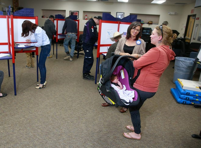 Presiding election judge Tanya Bounds, left, helps Julie Wendeborn vote in a file photo from November 2016 at the San Juan County Fire Operations Center in Aztec.