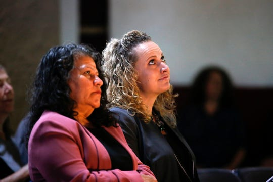Isela Imelda Baca de Polanco, left, and Daniella Marie Montano listen Friday during a naturalization ceremony at Aztec Ruins National Monument.