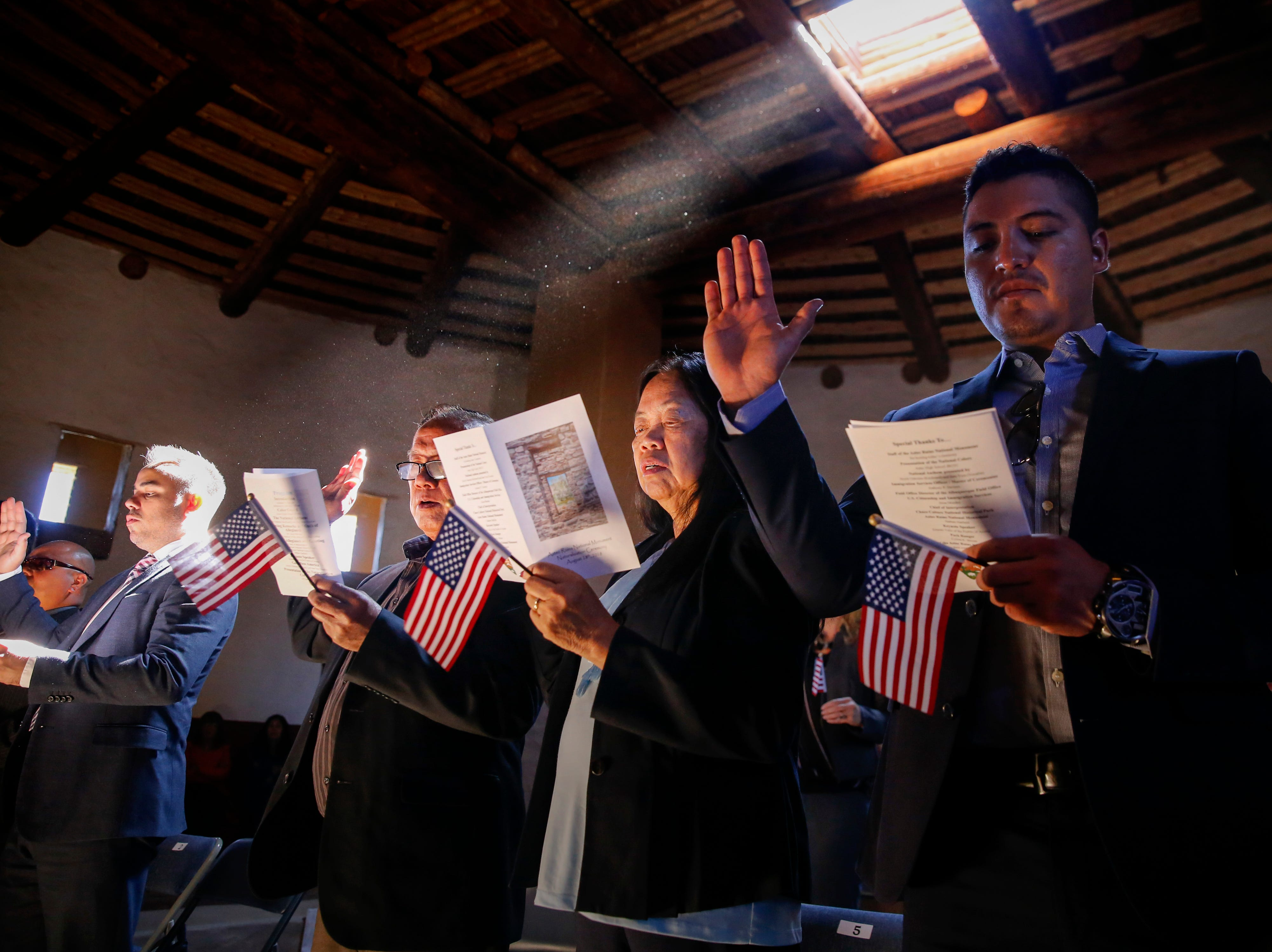 From left, Juan Luis Núñez, Norman Enriquez, Rudolpho Mosqueda, Nenita Mosqueda and Jose Luis Perez take the oath of citizenship, Friday, Sept. 28, 2018 during a naturalization ceremony at the Aztec Ruins National Monument.
