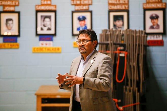 Leonard Gorman, executive director for the Navajo Nation Human Rights Commission, welcomes participants during a seminar on hate crimes Friday at the Shiprock Chapter house.