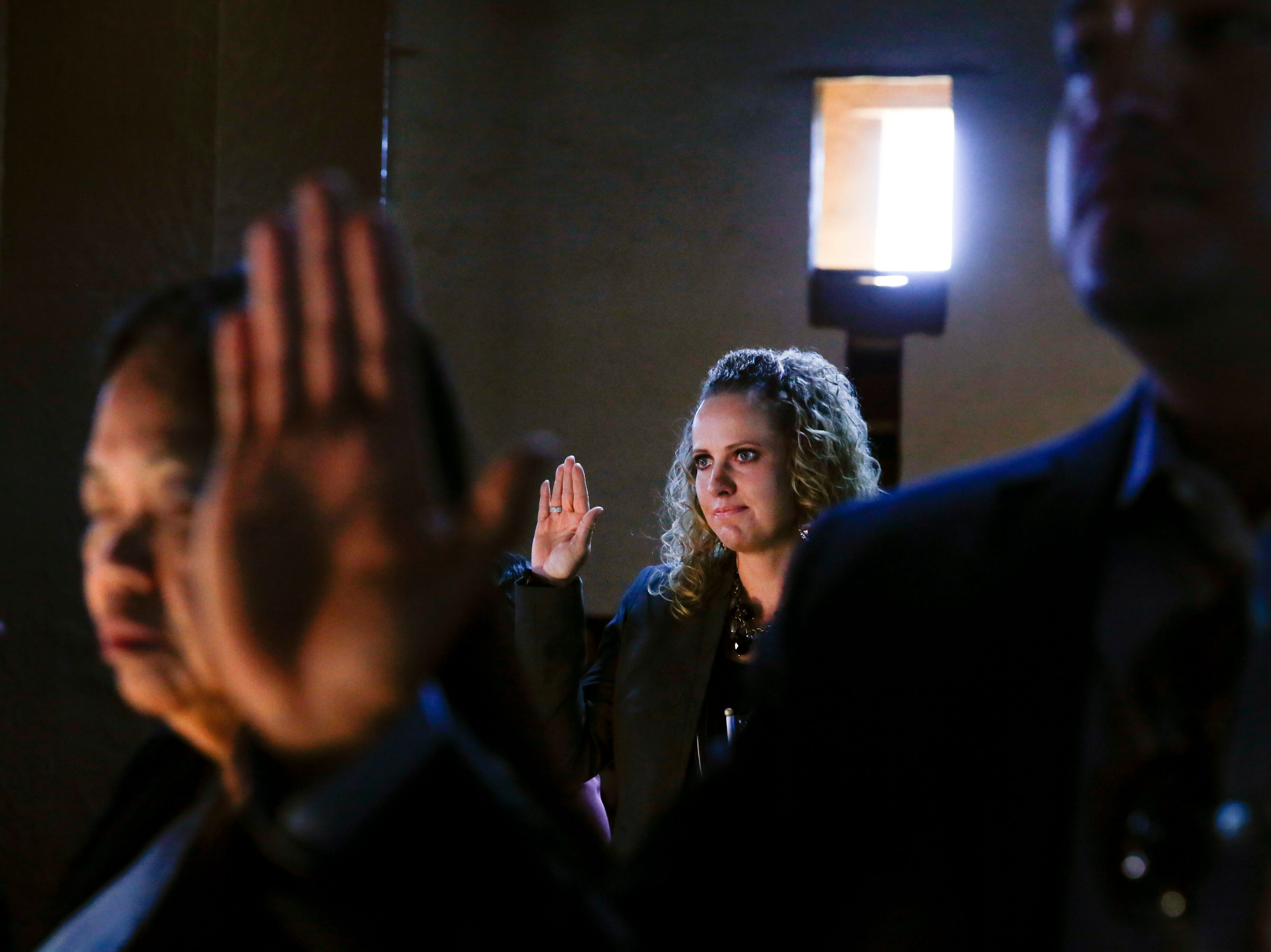 Daniella Marie Montano takes the oath of citizenship on Friday, Sept. 28, 2018 during a naturalization ceremony at the Aztec Ruins National Monument.