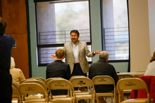 Leonard Gorman, executive director for the Navajo Nation Human Rights Commission, speaks during a seminar on hate crimes Friday at the Shiprock Chapter house.
