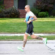 Allen Hutchinson runs the streets of Royal Oak to prepare for the IRONMAN World Championships scheduled for Oct. 13 in Hawaii.