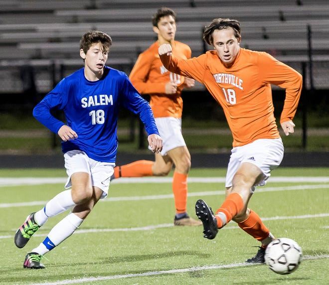 Salem's Andrew Schwartz (left) and Northville's Harrison Neal contest for the 50-50 ball.