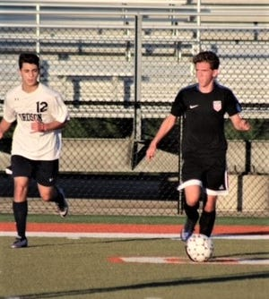 John Glenn soccer player Blake Grove (right) was voted Hometown Life Prep Athlete of the Week.