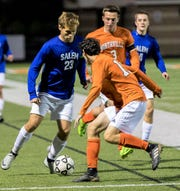 Salem's Bryan Rodwell (left) tries to play keep away from Northville defenders Mitchell Johnson (middle) and Brian Politi (3).