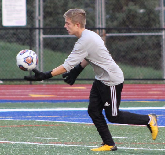 Farmington's senior goalie Evan Yaros gets set to boot the ball downfield Thursday against North Farmington.