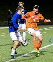 Northville's Brian Politi and Salem's Thomas Dono get locked up in Thursday's KLAA East Division clash.