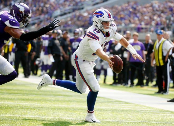 Buffalo Bills quarterback Josh Allen (17) runs from Minnesota Vikings linebacker Anthony Barr, left, during the first half of an NFL football game, Sunday, Sept. 23, 2018, in Minneapolis. (AP Photo/Bruce Kluckhohn)