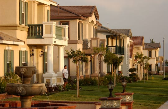 New houses line the street in the Inland Empire, the area east of Los Angeles, in Riverside and San Bernardino Counties, May 23, 2003 in Ontario, California.