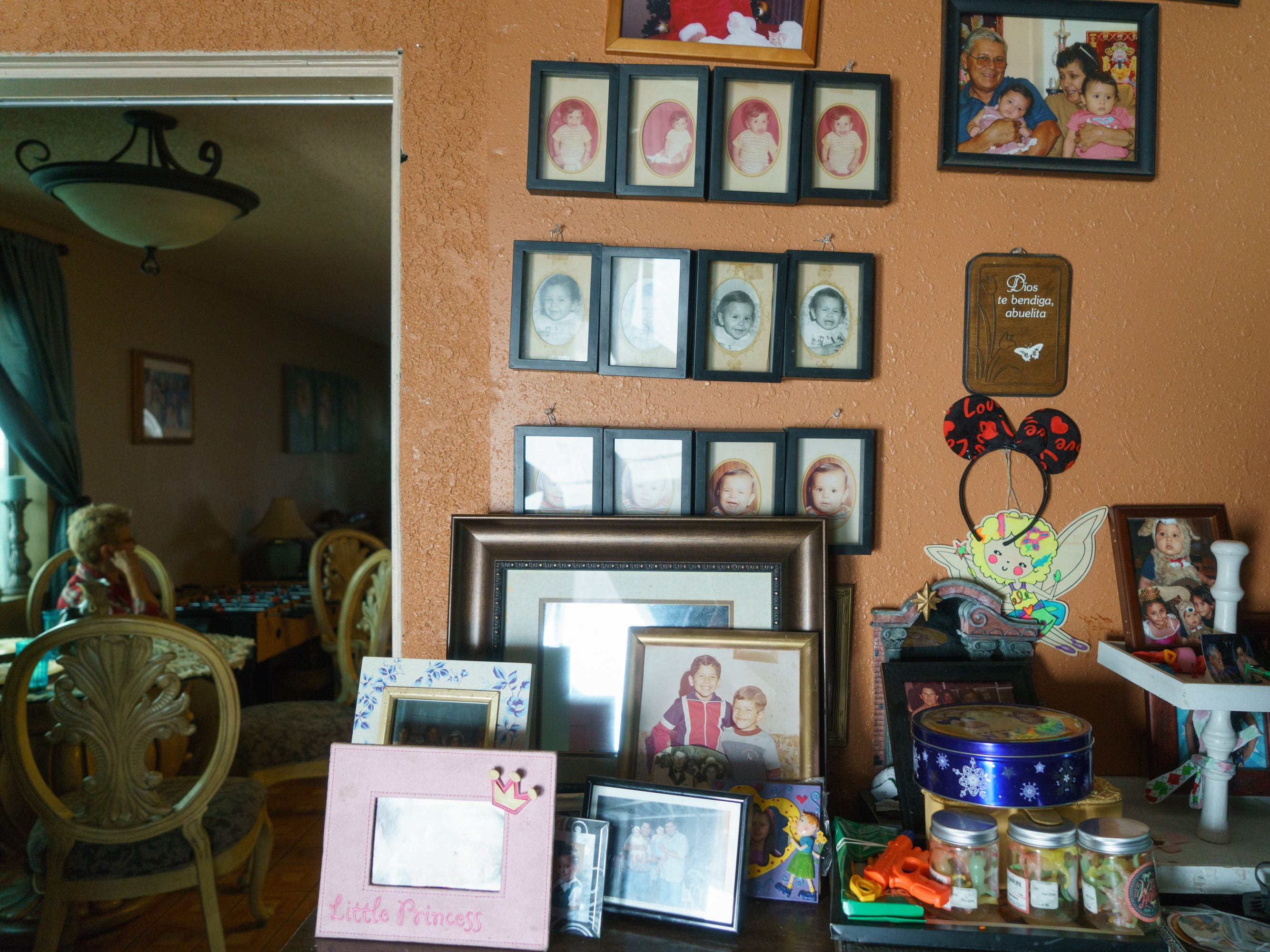 A wall in Ernestina Calderón's house is covered with family photos.