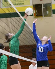 Coachella Valley senior Miranda Torres, left, goes  up high to tip away a ball against Cathedral City.
