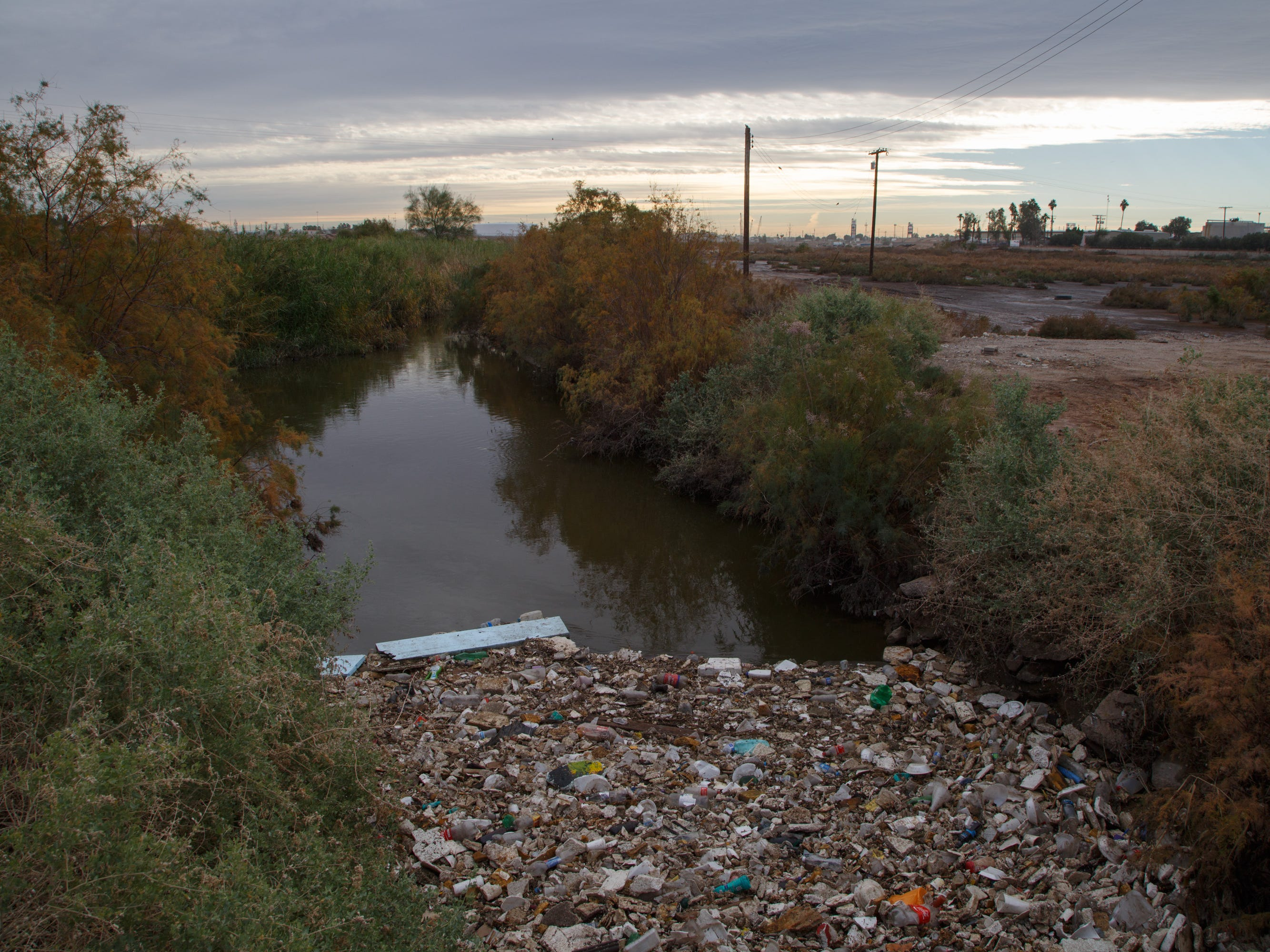 Trash collects in the New River near the border in Calexico.